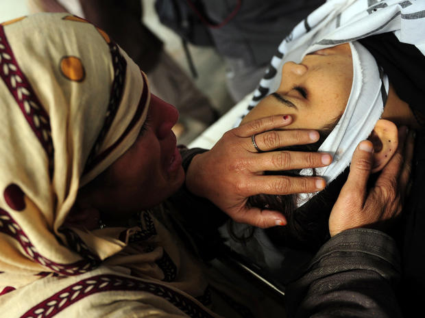 A Pakistani mother mourns her daughter, who was killed working for a polio vaccination program