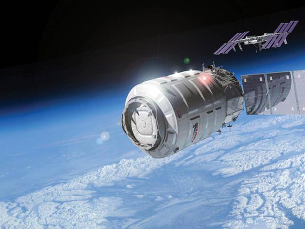 Cygnus cargo logistics spacecraft approaching the ISS.
