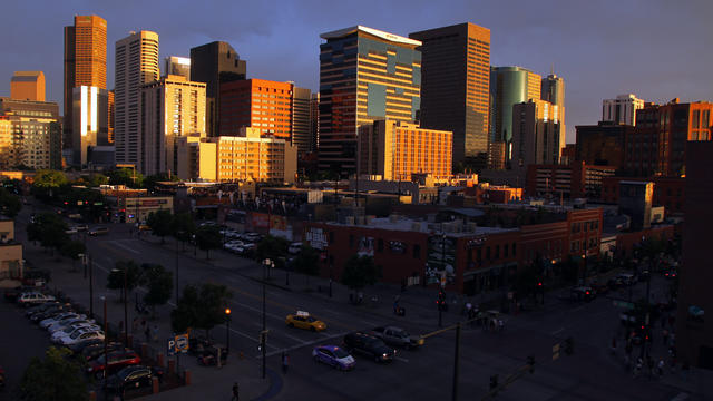 The sun sets on downtown Denver as seen from its LoDo neighborhood May 5, 2012.
