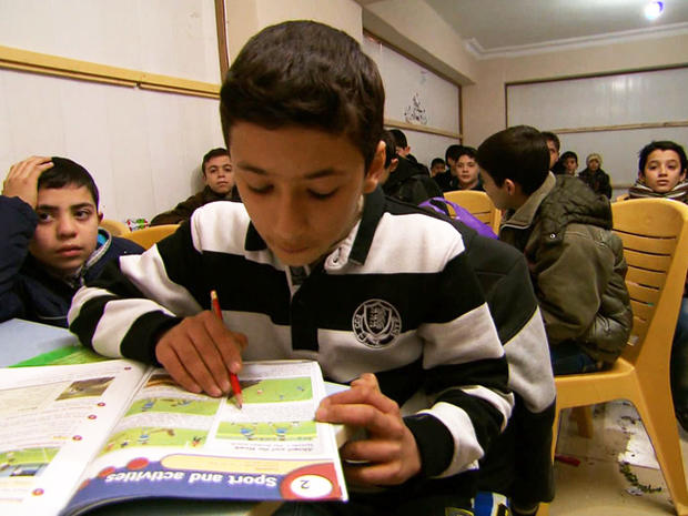Omar, 13, attends a makeshift school in Turkey with 500 other children who have fled Syria's civil war.