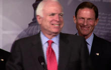 """McCain jokes about """"waterboarding"""" Kerry at confirmation hearing"""