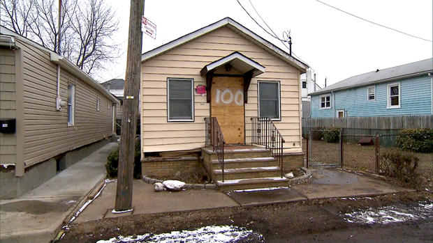 A picture of a house heavily damaged by superstorm Sandy on Staten Island, 100 days after the storm hit.