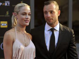South African Olympic athlete Oscar Pistorius and his girlfriend Reeva Steenkamp are seen at an awards ceremony in Johannesburg Nov. 4, 2012.