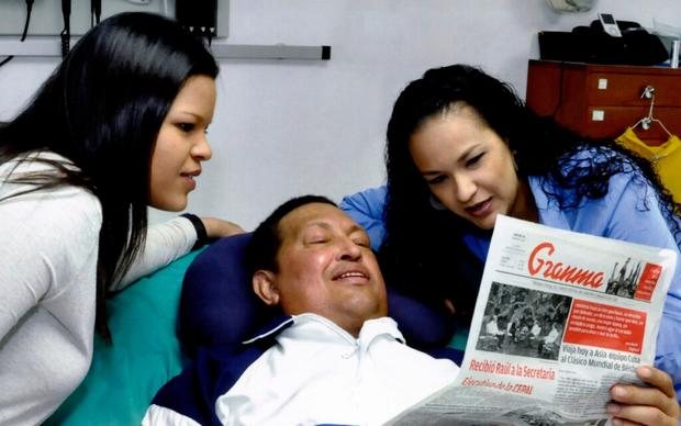 Hugo Chavez with his daughters, Maria Gabriela, left, and Rosa Virginia