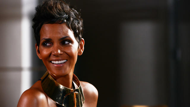 Halle Berry, still in wardrobe, smiles after shooting with Bruce Weber.