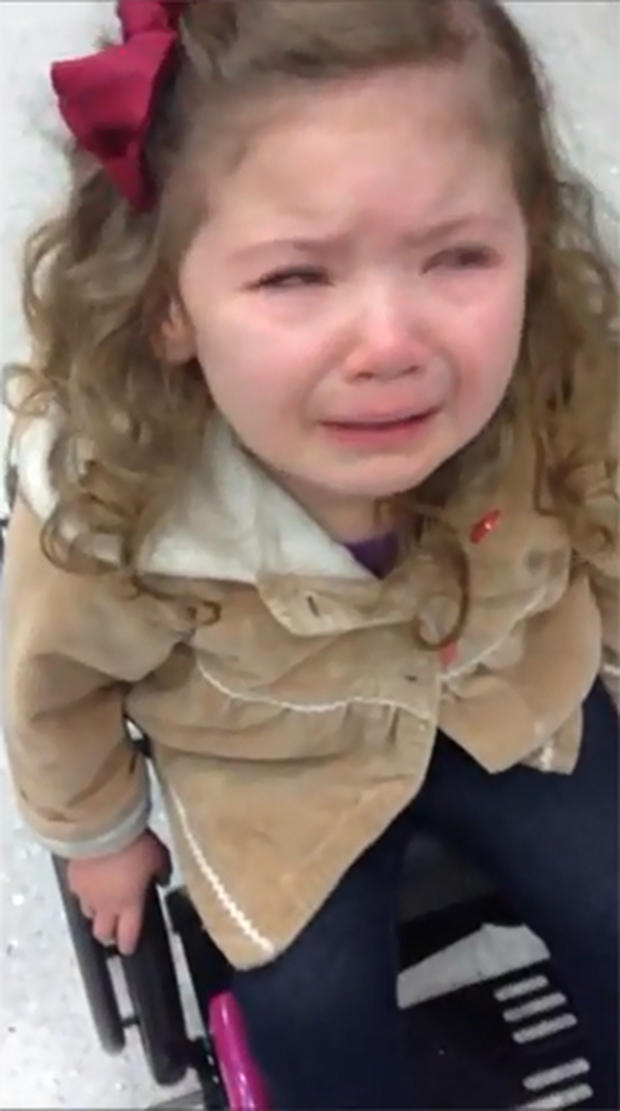 Lucy, 3, cries during a TSA security checkpoint at Lambert airport in St. Louis