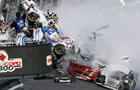 Kyle Larson's car (32) gets airborne during a multi-car wreck on the final lap of the NASCAR Nationwide Series auto race Feb. 23, 2013, at Daytona International Speedway in Daytona Beach, Fla.