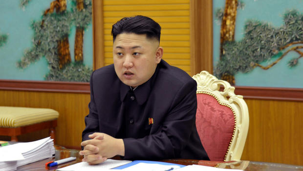 undated file photo released by the Korean Central News Agency and distributed Sunday, Jan. 27, 2013 in Tokyo by the Korea News Service, North Korean leader Kim Jong Un attends a consultative meeting with officials in the fields of state security and forei