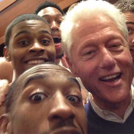 Bill Clinton celebrates with Louisville players