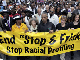 """In this June 17, 2012 file photo, Rev. Al Sharpton, center, walks with thousands along Fifth Avenue, during a silent march to end the """"stop-and-frisk"""" program in New York."""