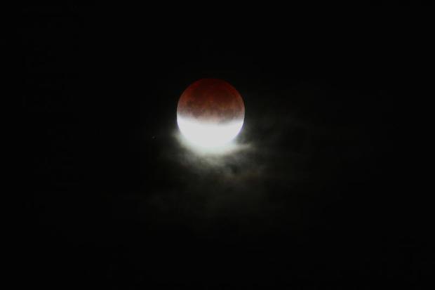 20_Eclipsed_Moon_Through_Clouds.jpg