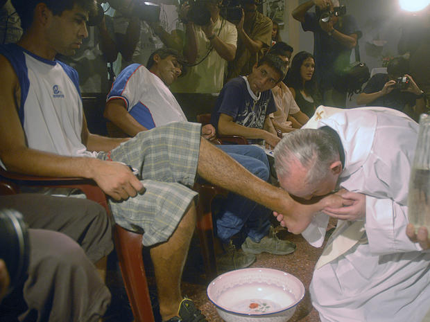 In this picture taken March 20, 2008, Pope Francis, at the time Cardinal Jorge Bergoglio, kisses the feet of a man during a mass with youth trying to overcome drug addictions in Buenos Aires, Argenti