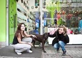 Ladies show Ruby, the anti-austerity dog, some love