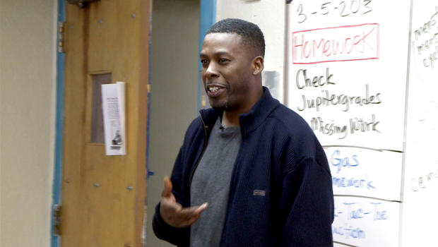 GZA of the Wu-Tang Clan works with students at Park East High School in New York City.