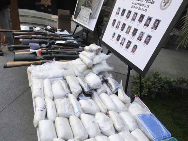 Weapons and drugs seized from the La Familia drug cartel are shown in San Bernadino, CA