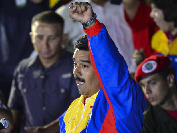 Venezuelan acting President Nicolas Maduro clench his fist while he celebrates after knowing the election results in Caracas on April 14, 2013. Venezuela's acting President Nicolas Maduro declared victory on Sunday in the race to succeed late leader Hugo Chavez after the electoral council announced that he had won in a close battle.