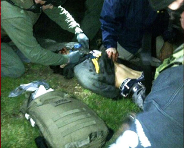 Dzokhar Tsarnaev lies on the ground after being detained by federal agents on Friday, April 19, 2013