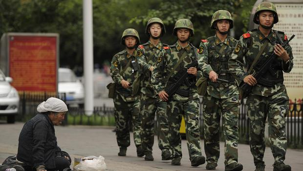 Image result for Chinese paramilitary police on patrol in Urumqi, capital of Xinjiang, afp, getty images