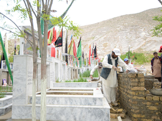Workers at at Quetta's Behesht-e-Zainab cemetery
