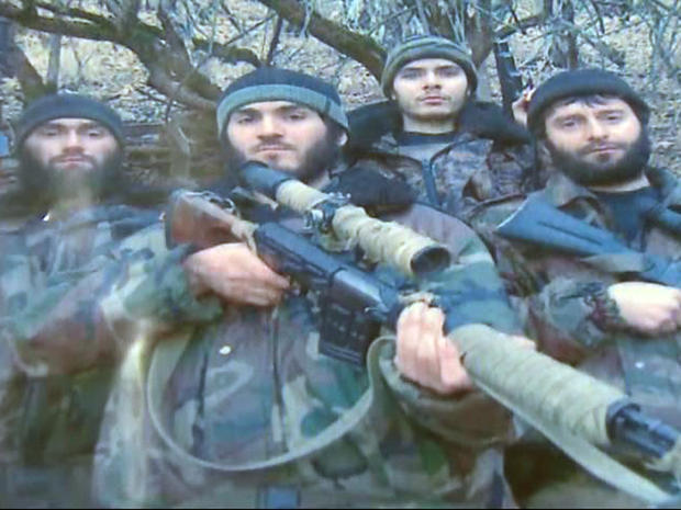 William Plotnikov, (third from left), is pictured in this undated photo with Islamist extremists in Dagestan.