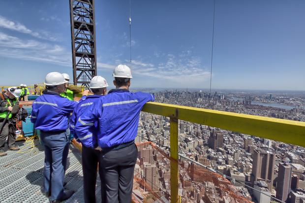 Scott Pelley visits the top of One World Trade before it was crowned with the final piece of the spire.