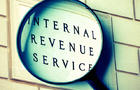 IRS sign with magnifying glass