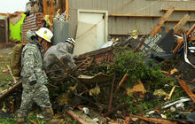 Oklahoma National Guardsmen comb through rubble
