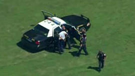 A man is apprehended by police responding to a shooting at Fort Sam Houston in San Antonio, Texas, on June 10, 2013.