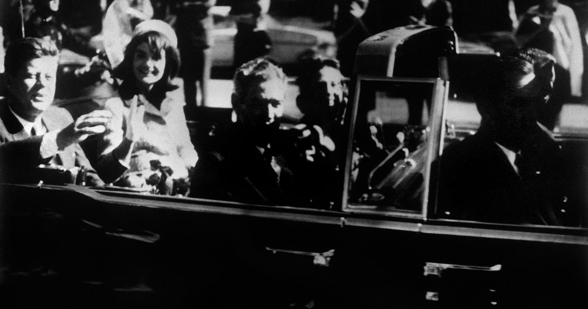 the tragedy of the assassination of john f kennedy and its controversial investigations John f kennedy and his wife jackie travel in the presidential motorcade in dallas before his assassination on 22 november 1963.