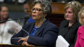 Rep. Senfronia Thompson, D-Houston, stands at the podium where she has hung a hanger from the microphone on the House floor as she attempts to add an amendment to create an exception for victims of rape and incest in Senate Bill 5 during debate at the State Capitol in Austin, Texas, on Sunday, June 23, 2013.