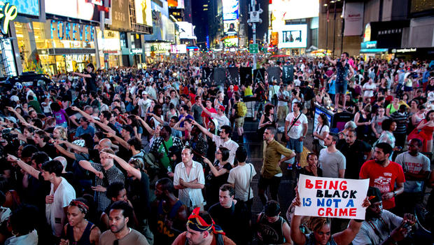 Throngs of marchers gather on Times Square, July 14, 2013, in New York, for a protest against the acquittal of volunteer neighborhood watch member George Zimmerman in the 2012 killing of 17-year-old Trayvon Martin in Sanford, Fla.