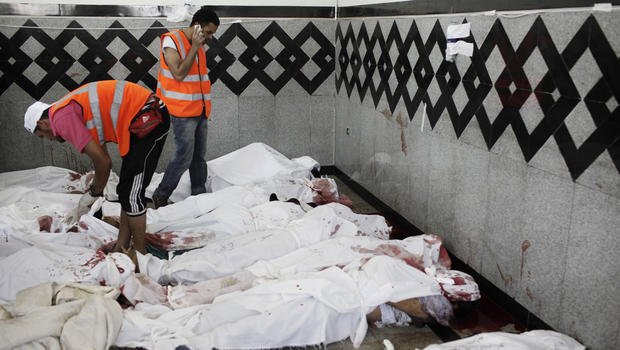 Bodies of supporters of deposed Egyptian President Mohammed Morsi lie on the floor of a field hospital, after reportedly being killed in fighting between pro-Morsi demonstrators and Egyptian security forces overnight, near the Rabaa al Adweya Mosque in the district of Nasr on July 27, 2013 in Cairo, Egypt.