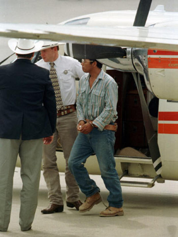 Accused serial killer Angel Maturino Resendiz, led by Sgt. Drew Carter of the Texas Rangers, arrives at Hobby Airport in Houston on Tuesday, July 13, 1999, after turning himself in to Carter in El Paso.