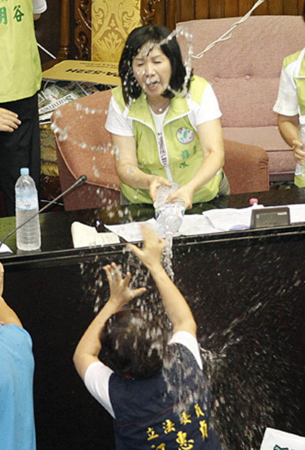 Ruling and opposition lawmakers fight with water on the legislature floor in Taipei, Taiwan, Aug. 2, 2013.
