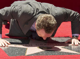 Actor Bryan Cranston gets up close with his newly unveiled star at the star presentation ceremony on the Hollywood Walk of Fame, July 16, 2013.