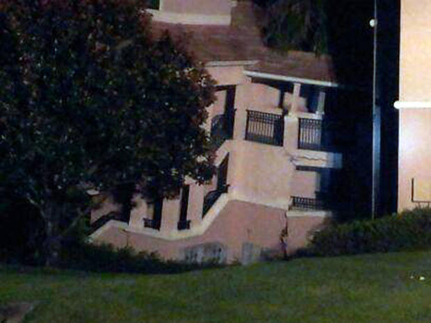 A building at the Summer Bay Resort in Clermont, Fla., shows damage from collapsing into a sinkhole early Aug. 12, 2013.