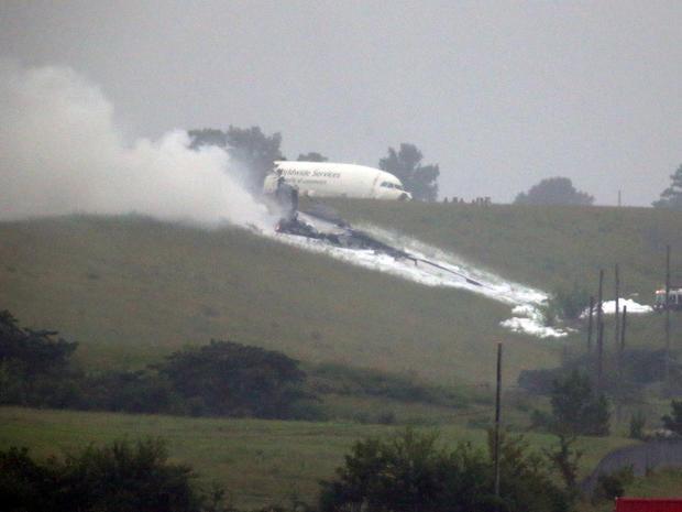 A UPS cargo plane lies on a hill at Birmingham-Shuttlesworth International Airport after crashing on approach Aug. 14, 2013, in Birmingham, Ala.