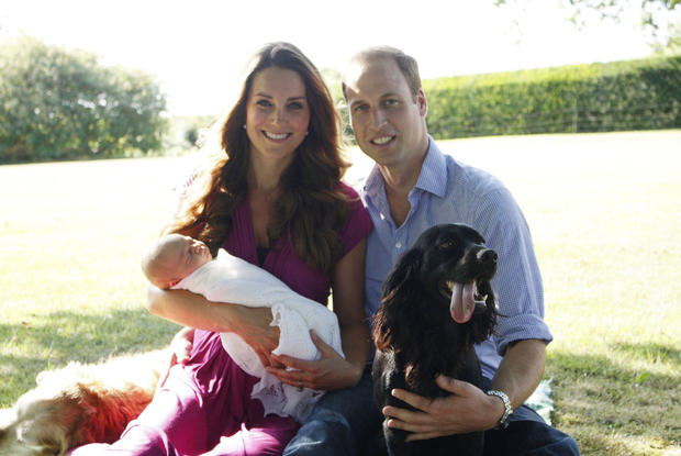 The Duke and Duchess of Cambridge and Prince George are pictured in early August in the Middleton's garden with a retriever called Tilly (a Middleton family pet), and with Lupo, the couple's Cocker Spaniel.