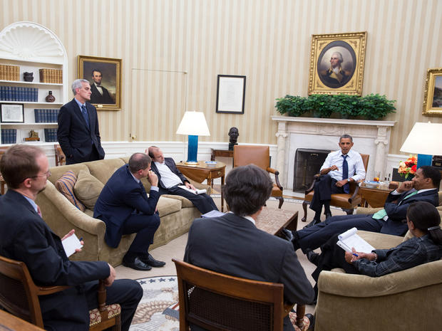 President Obama meets with senior advisers in the Oval Office to discuss the situation in Syria Aug. 30, 2013.
