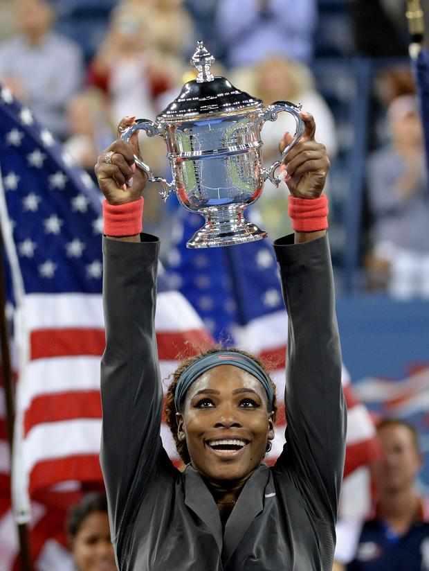 Serena Williams holds the trophy as she celebrates her win over Victoria Azarenka of Belarus during their 2013 US Open women's singles final match in New York City.