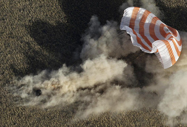 Soyuz capsule returns ISS astronauts to Earth