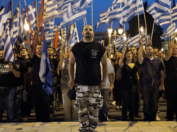 Members and supporters of the ultra-nationalist Golden Dawn party