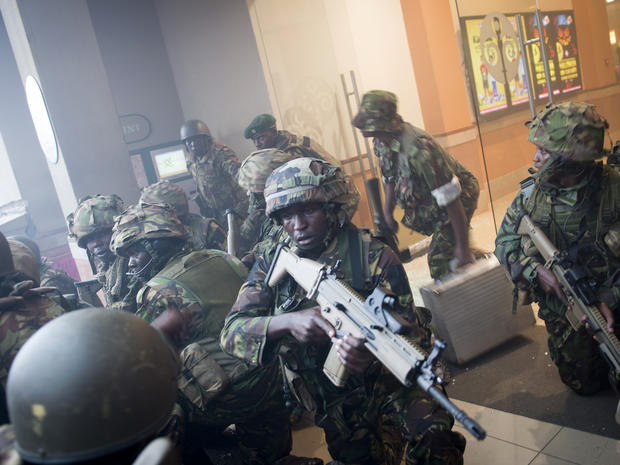 Armed police leave after entering the Westgate Mall in Nairobi, Kenya, Sept. 21, 2013.