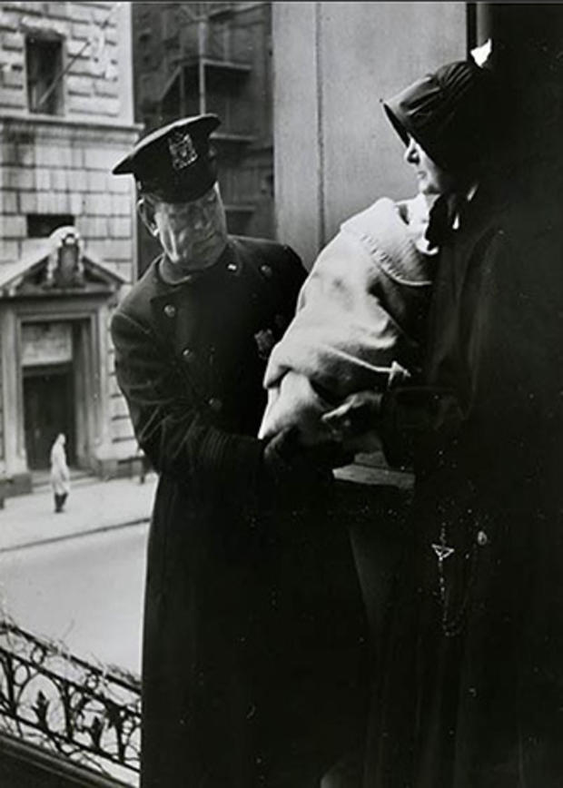 020_Sister_of_Charity_receiving_a_found_infant_from_local_police.jpg