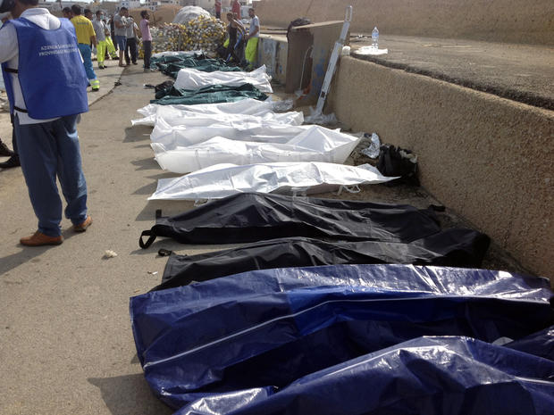 Bodies of drowned migrants are lined up in the port of Lampedusa, Italy, Oct. 3, 2013.