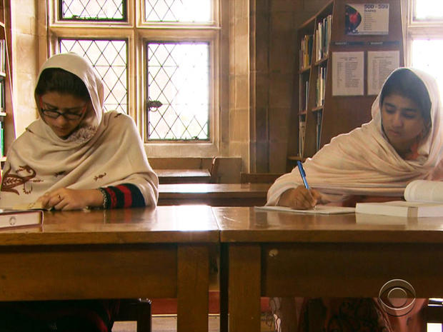 Kainat Riaz and Shazia Ramzan study in the library at Atlantic College.