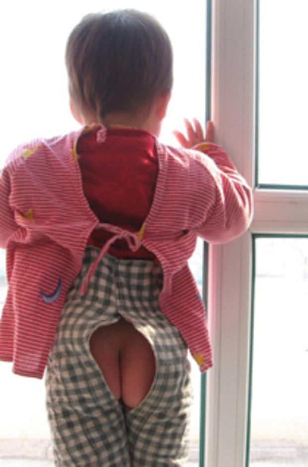 A child wearing Chinese diapers, or split pants called kaidangku
