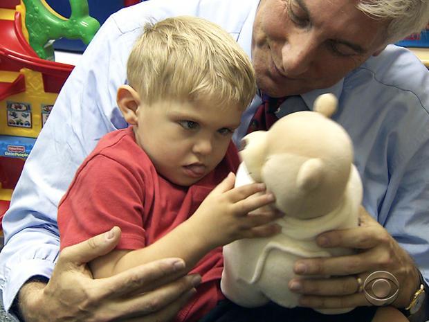 Grayson plays with Dr. Jon LaPook.