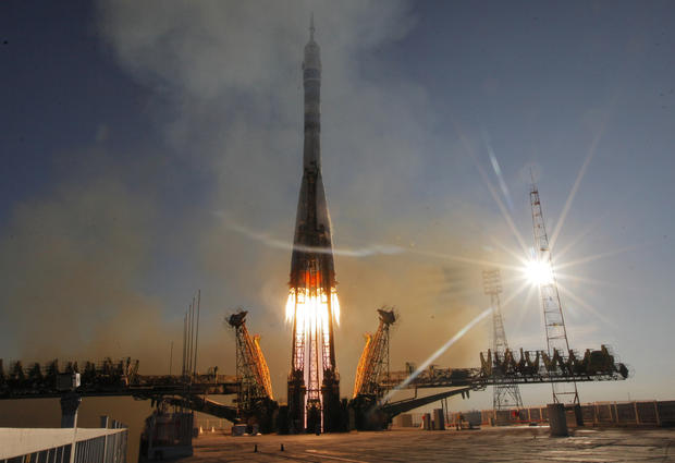 Soyuz carries Olympic torch to space
