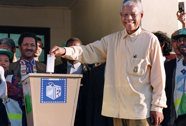 ANC President Nelson Mandela casts his historic vote during South Africa's first democratic and all-race general elections on  April 27, 1994.